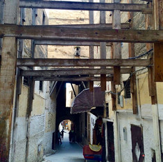 One of the typical alleyways in Fez old city under renovation. The buildings are being protected by crossing beams - photo by Shabnam Arabi
