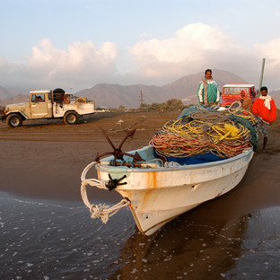 Fishermen with their boat and fishing equipment