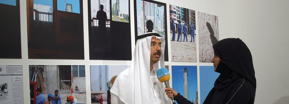 H.E Mohamad Al Murr in front of Mohammad Kazim's work