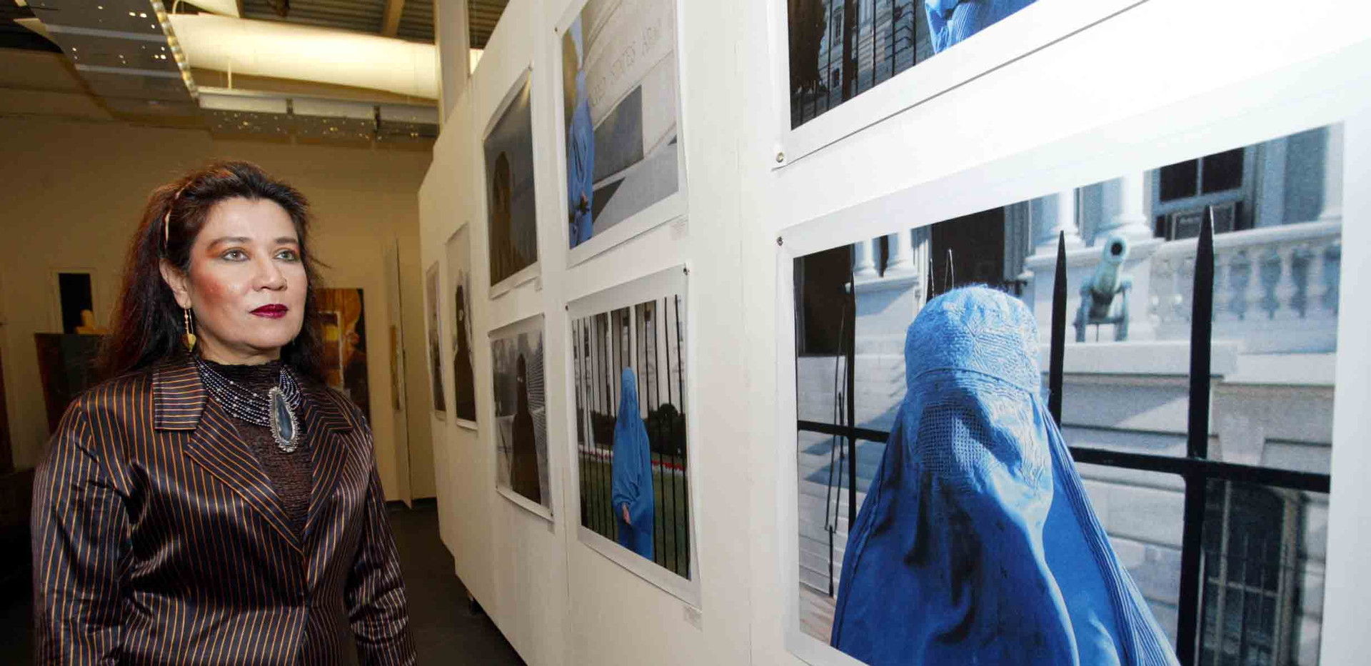 Mansoora Hassan in front of her work, Burqa series
