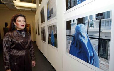 Mansoora Hassan in front of her work, Burqa series