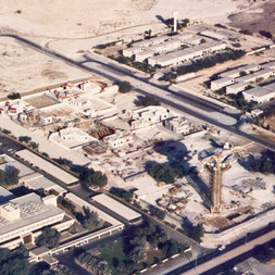 Aerial photo of Al Khazzan water tower and park under construction in 1983