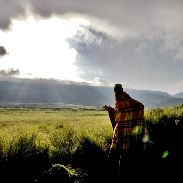 A Masai tribesperson against the backdrop of the  serengeti, Tanzania
