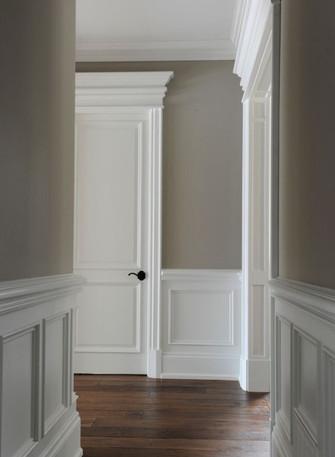 White raised panel in hallway