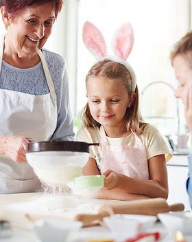A grandma baking with her grandchildren