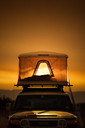 12_-_Our_rooftop_tent_glowing_at_sunset_