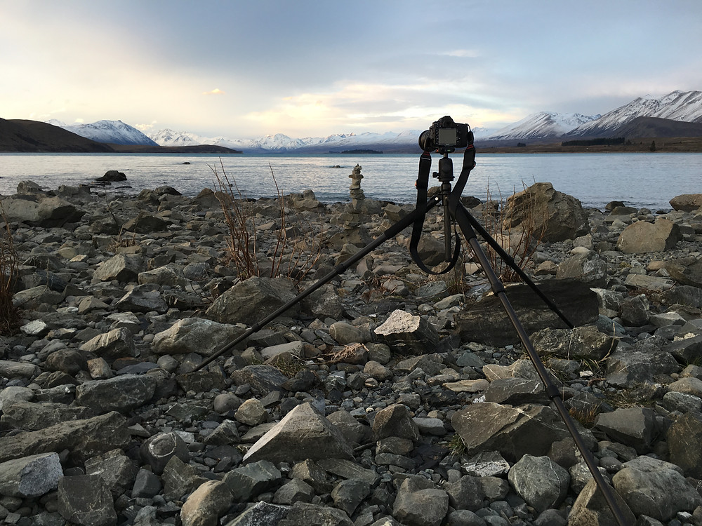 Photographing the lake and mountains