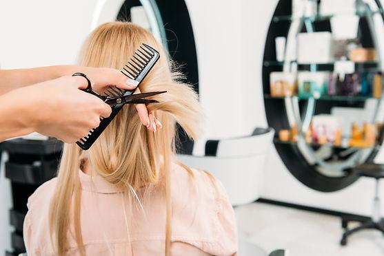 Blonde Girl Getting her haircut