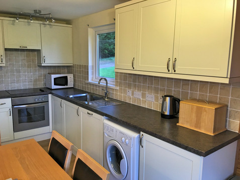Equipped kitchen with laundry facilities