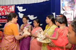 Intl Women's Day 090316 Vice president of ICID felicitating
