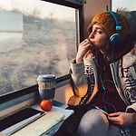 191211-stock-woman-travel-headphones-ew-