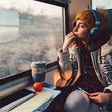 191211-stock-woman-travel-headphones-ew-