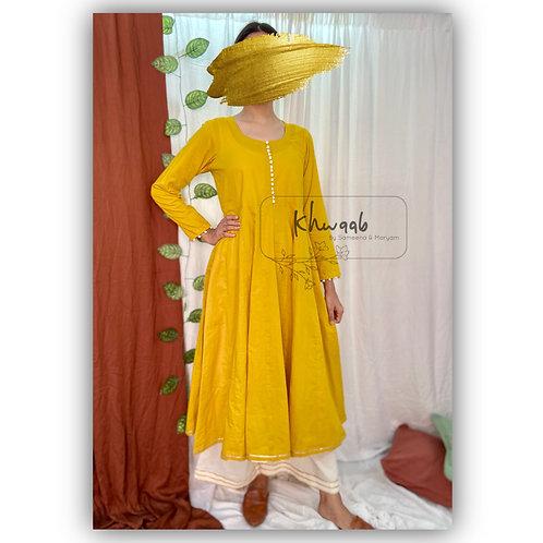 Solid mustard yellow Anarkali kurta with off white plazzo pant.