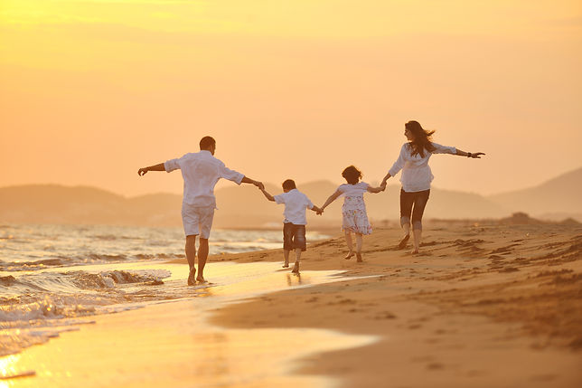 happy young family have fun on beach run