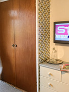 There's plenty of storage in the wardrobe and chest of drawers. There is a TV with Freeview as well as free WiFi.