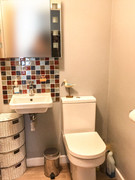 The bathroom has a full size bath with shower over, heated towel rail and mirror.