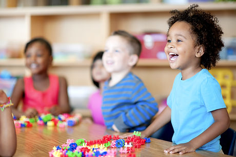 Toddlers in class smiling and happy
