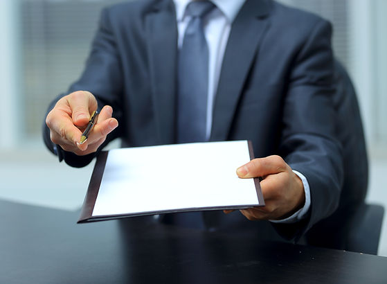Businessman giving pen for your signatur