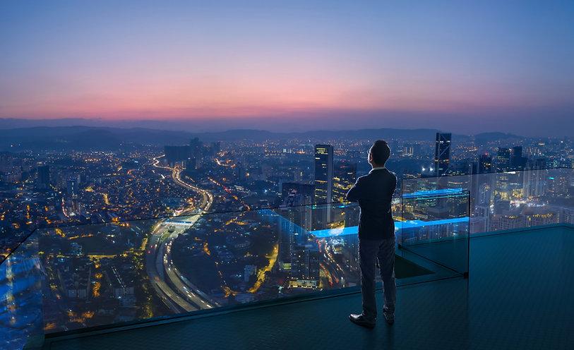 Businessman standing on open roof top ba