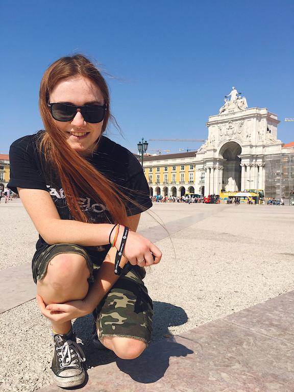 Female travel blogger in Praça do Comércio, Lisbon