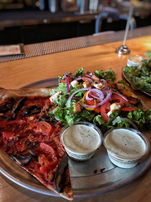 Pizza and salad at Sizzle Pie