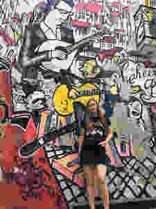 Female travel blogger with street art in Lisbon
