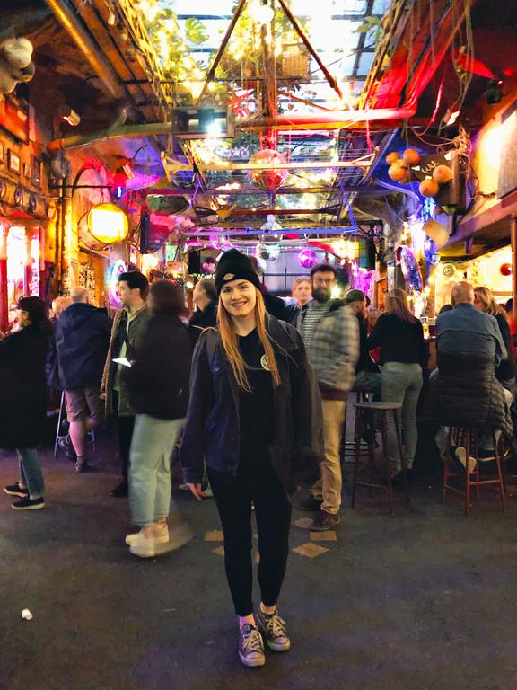 Female travel blogger at Szimpla Kert, Budapest