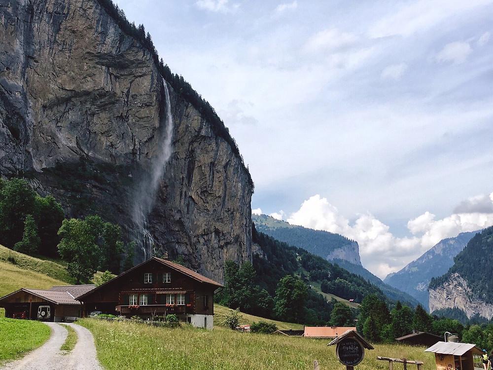 Staubbachfälle behind houses in Lauterbrunnen
