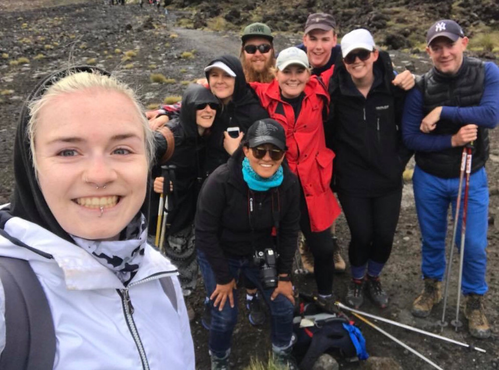 Travellers about to hike the Tongariro Alpine Crossing in New Zealand
