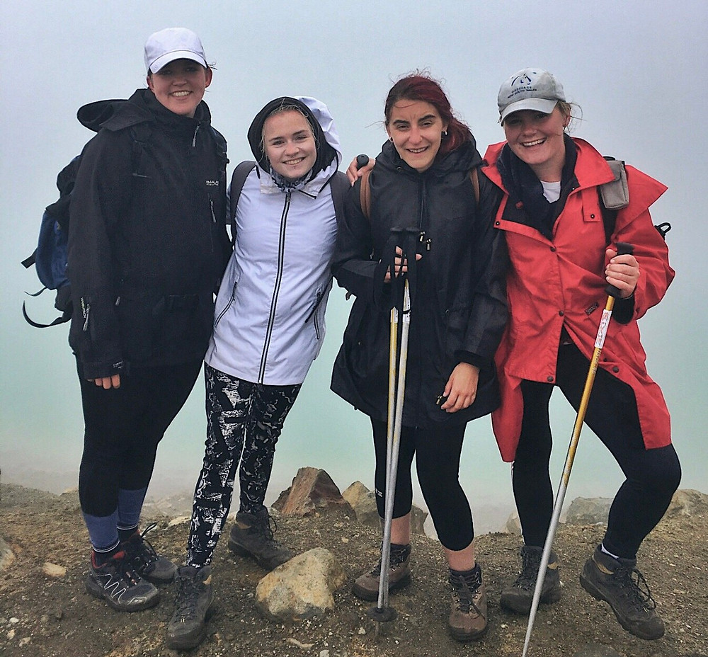 Four travellers midway through the Tongariro Crossing hike in New Zealand