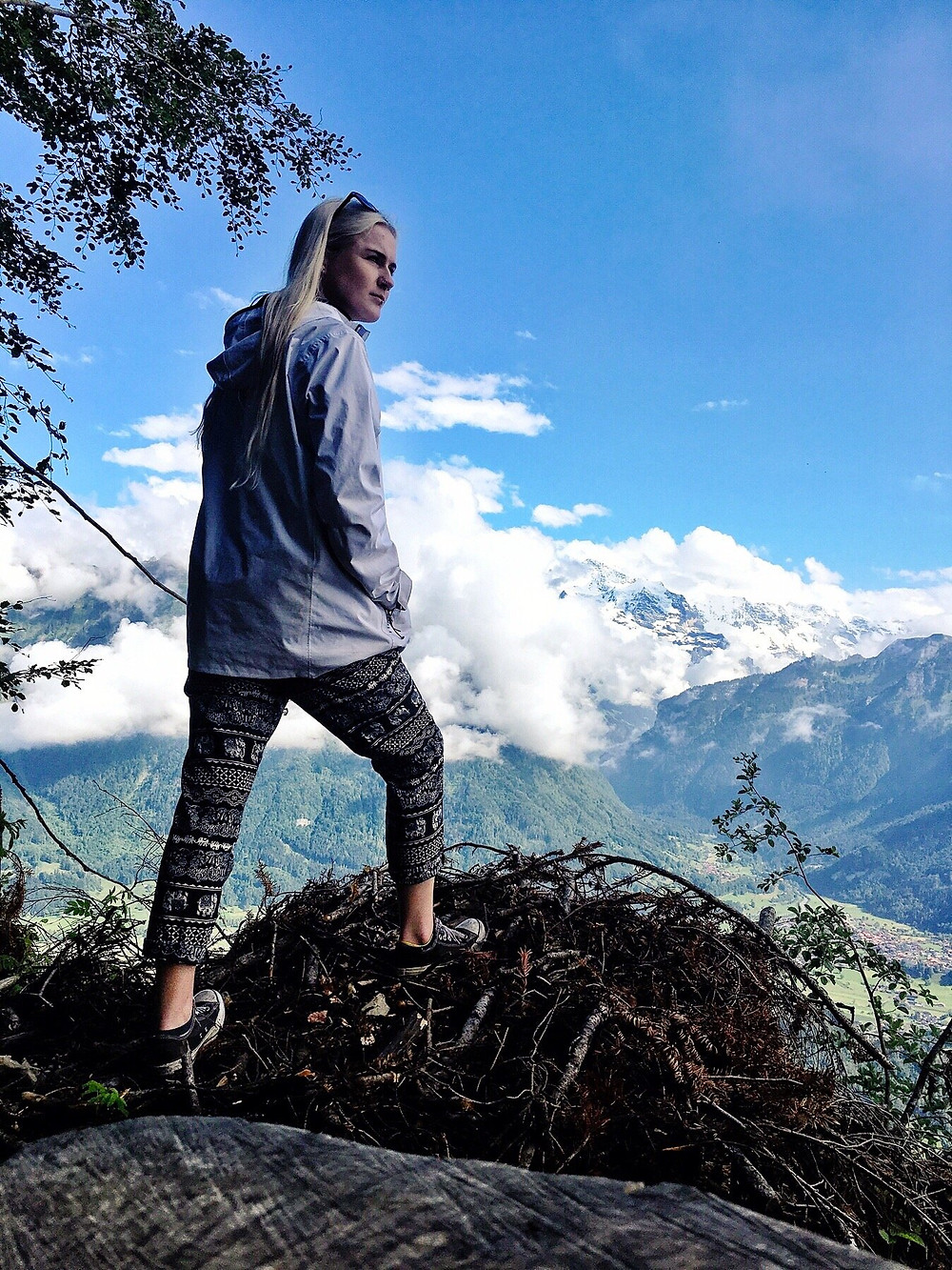 Travel blogger overlooking Interlaken from the lookout point at Harder Kulm