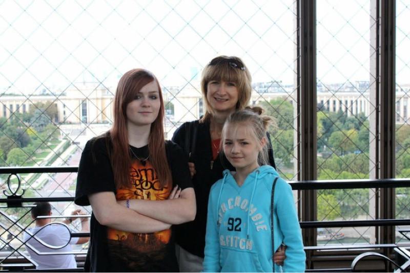 Mother and daughters in Eiffel Tower