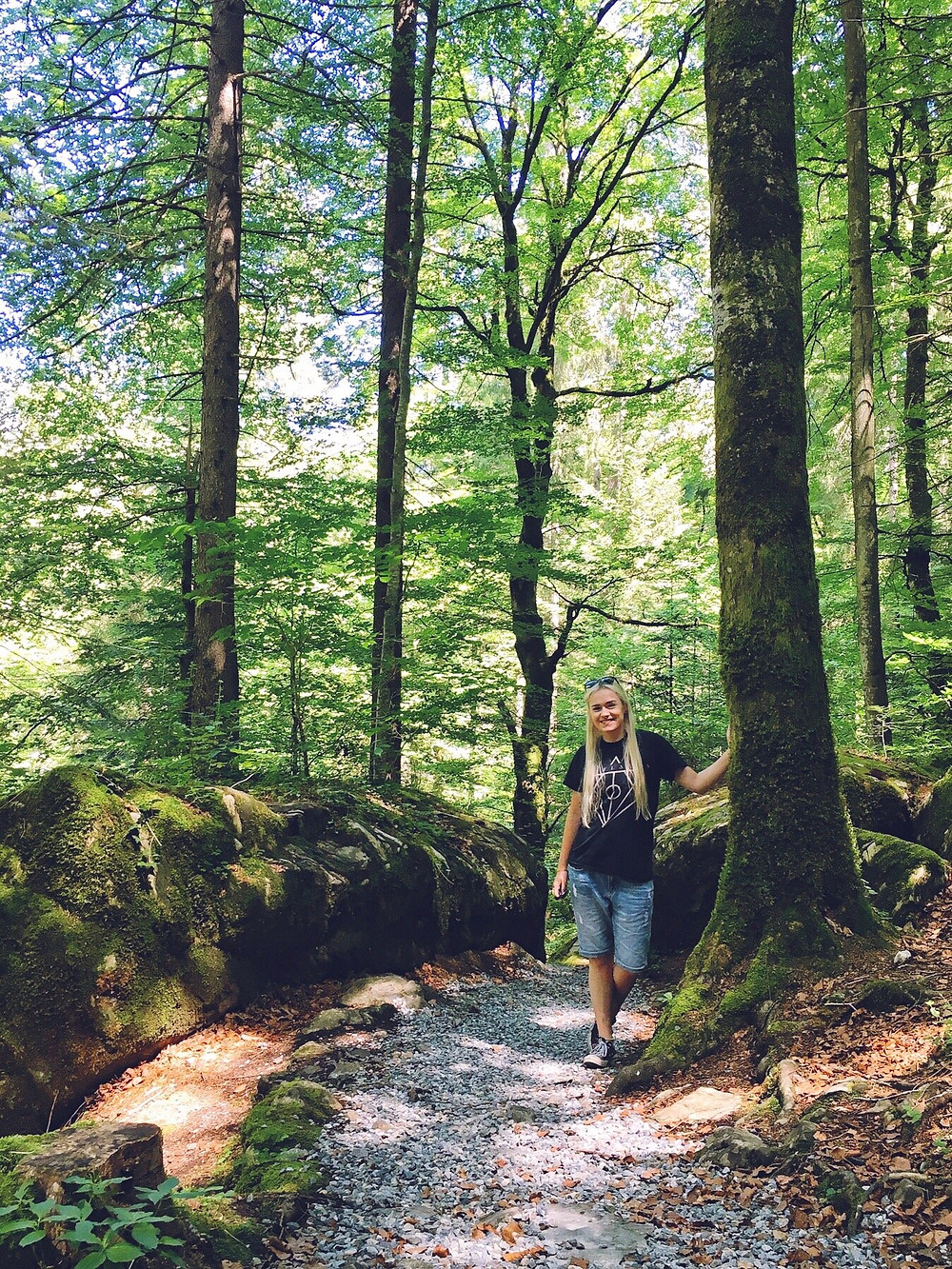Female travel blogger in Blausee forest