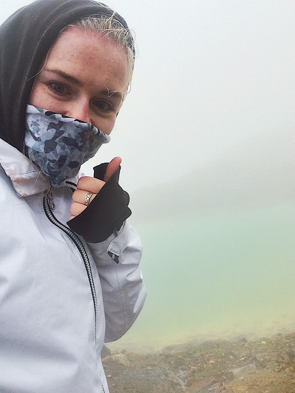 Cloudy view of the Emerald Lake on the Tongariro Alpine Crossing with poor visibility