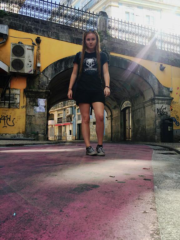 Female travel blogger at Lisbon's Pink Street