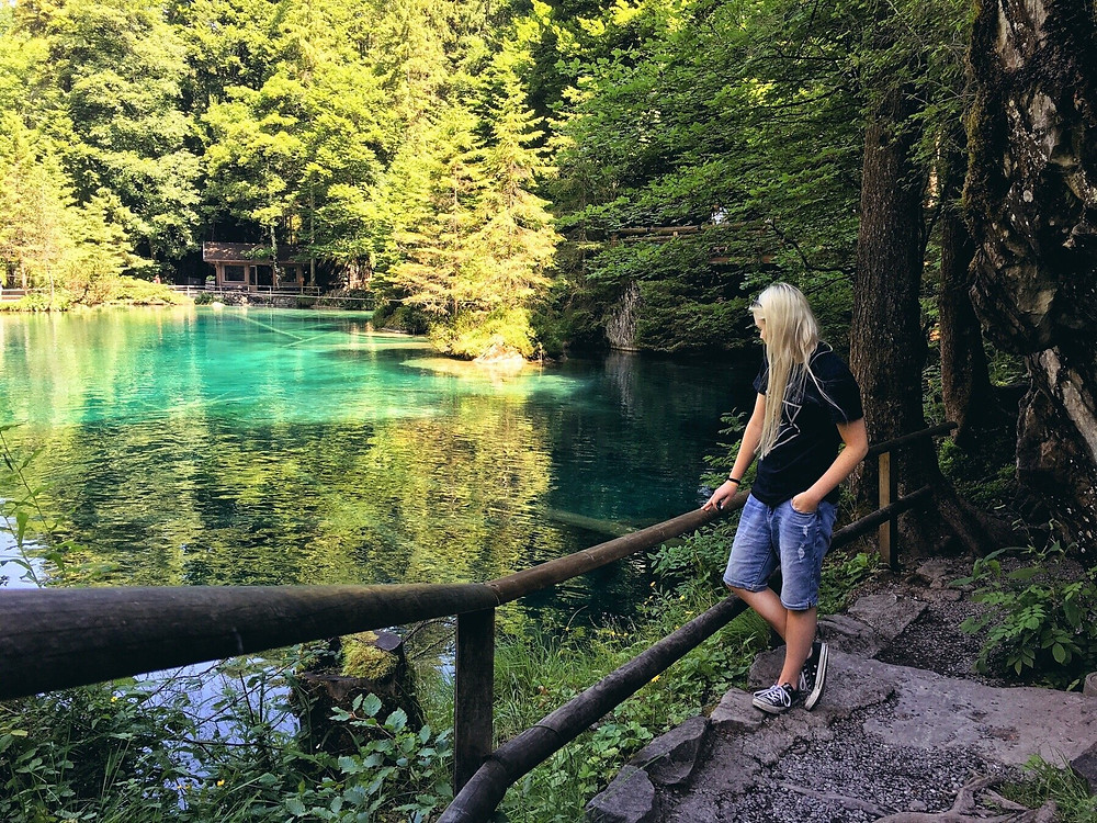 Female travel blogger overlooking Blausee