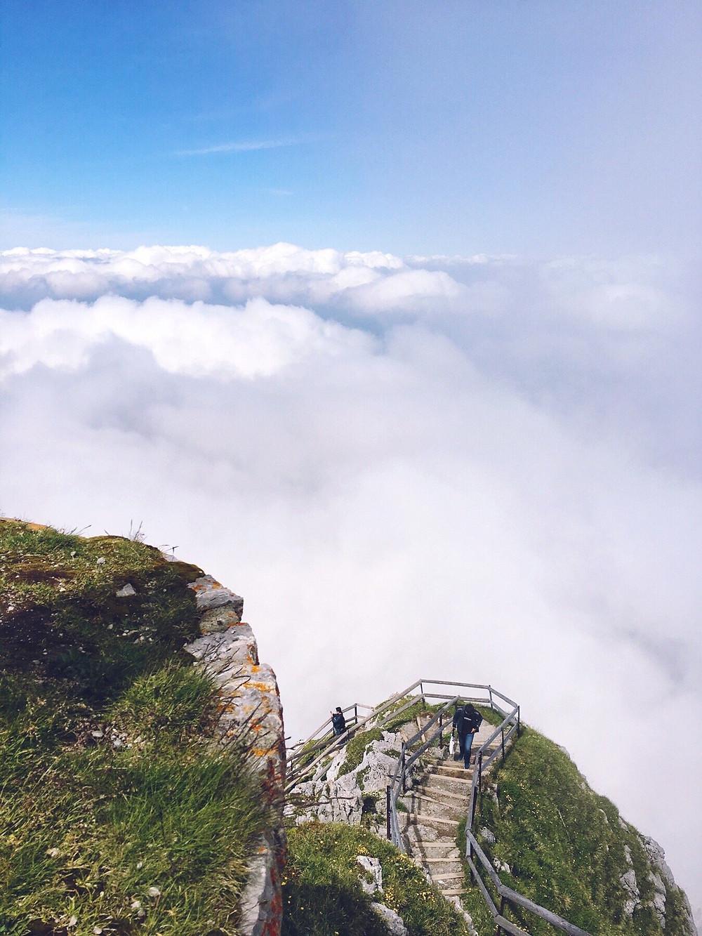 Tourists hiking up to the peak of Mount Pilatus