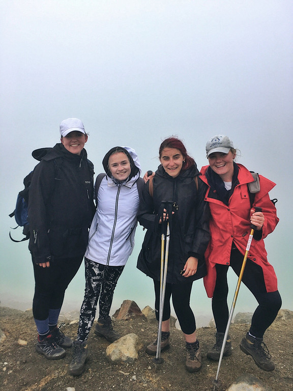 Hikers on the Tongariro Alpine Crossing in poor visibility