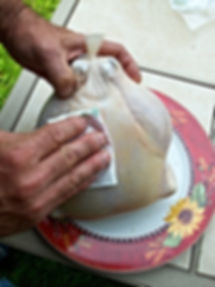 putting a label on a poultry shrink bag