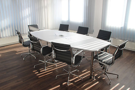Clean Boardroom With Light Coming Through The Blinds