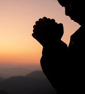 silhouette-girl-praying-beautiful-sky-ba