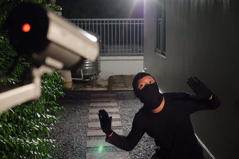 Thief wearing black suit with balaclava