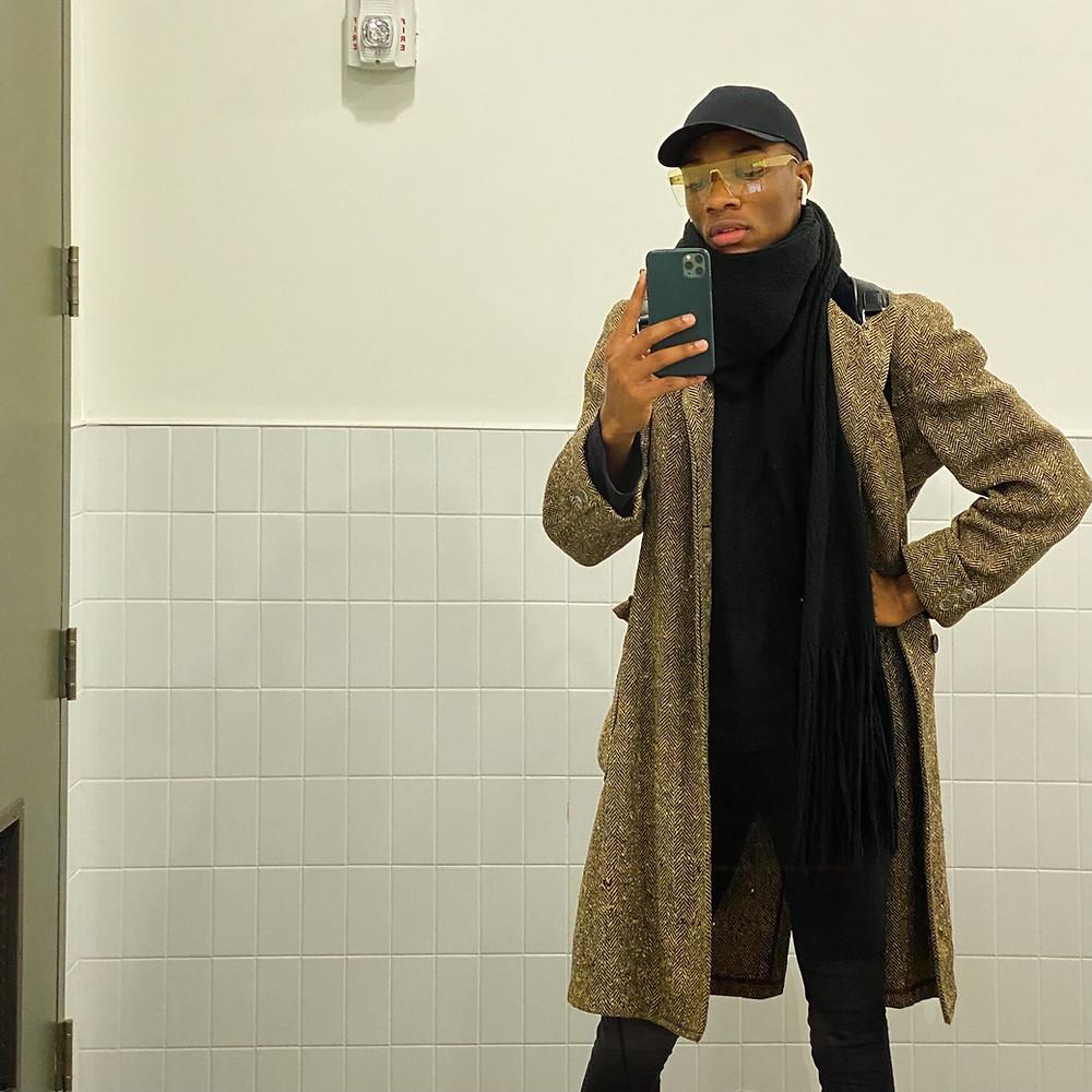 Picture of KIRU standing in a bathroom c.2019.
