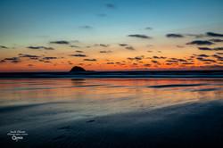 SUNSET OVER MURIWAI BEACH