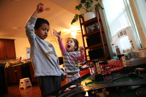 Arthur Fulcher, left, and his sister, Jane, right, scramble for a monitor of toy car on Thursday, November 28, 2019 in Columbia, Missouri. Arthur and Jane were born in a religious and multicultural family. Besides attending the Sunday school and studying the Bible, they are little kids loving playing toys and hide-and-seek.