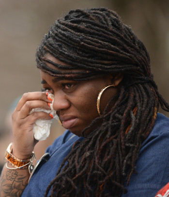 Starlita Benson wipes tears during the MU Remembers wreath-laying ceremony on Friday, April 5, 2019 at Francis Quadrangle, Columbia, Missouri. Perri Jones, Benson's sister and an MU student in the College of Arts and Science, was killed in a car crash last year.