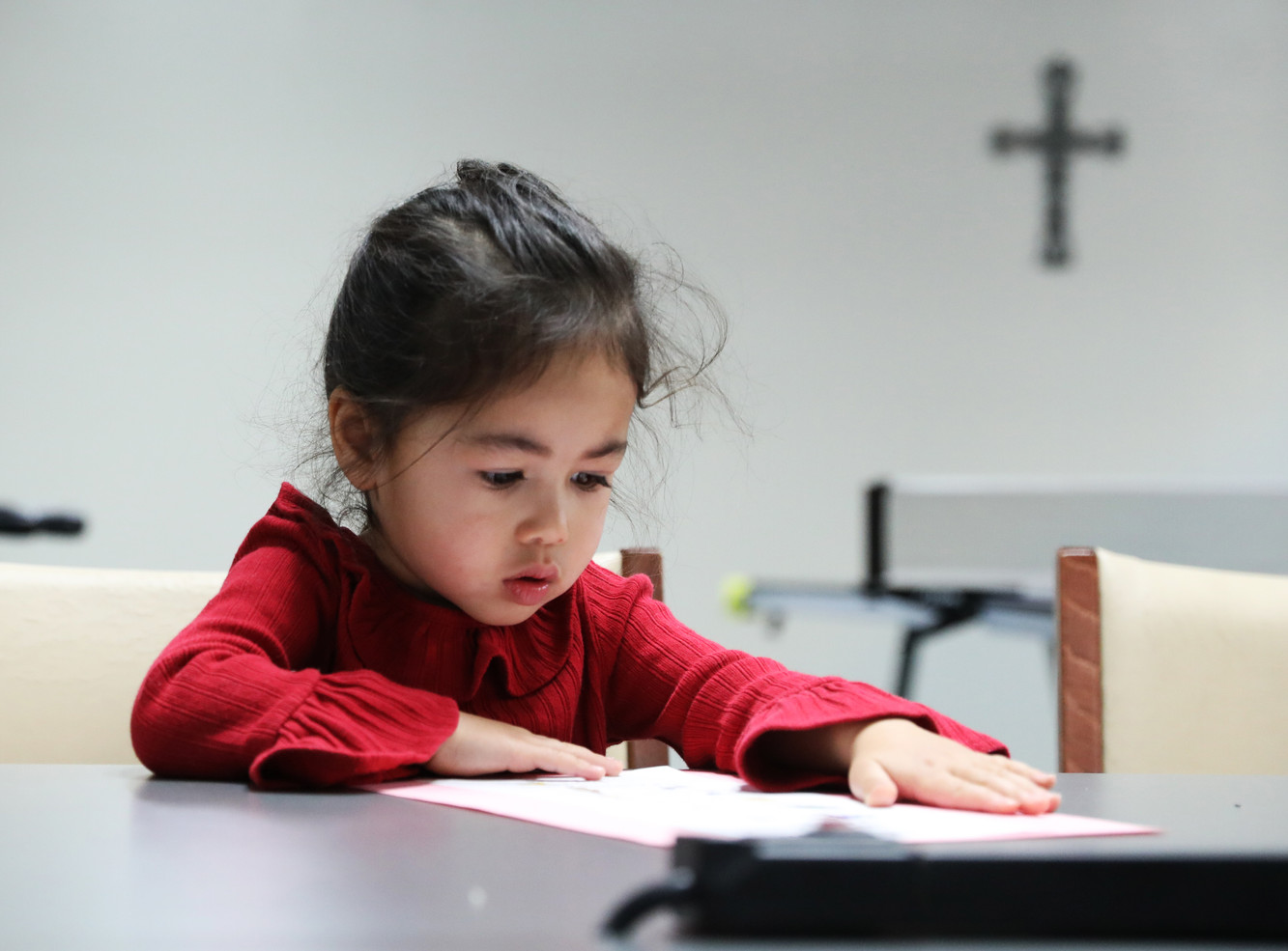 Jane sticks two papers with glue on Sunday, November 10, 2019 in Children's Sunday School in International Community Church, Columbia, Missouri. The whole family go to church every Sunday.