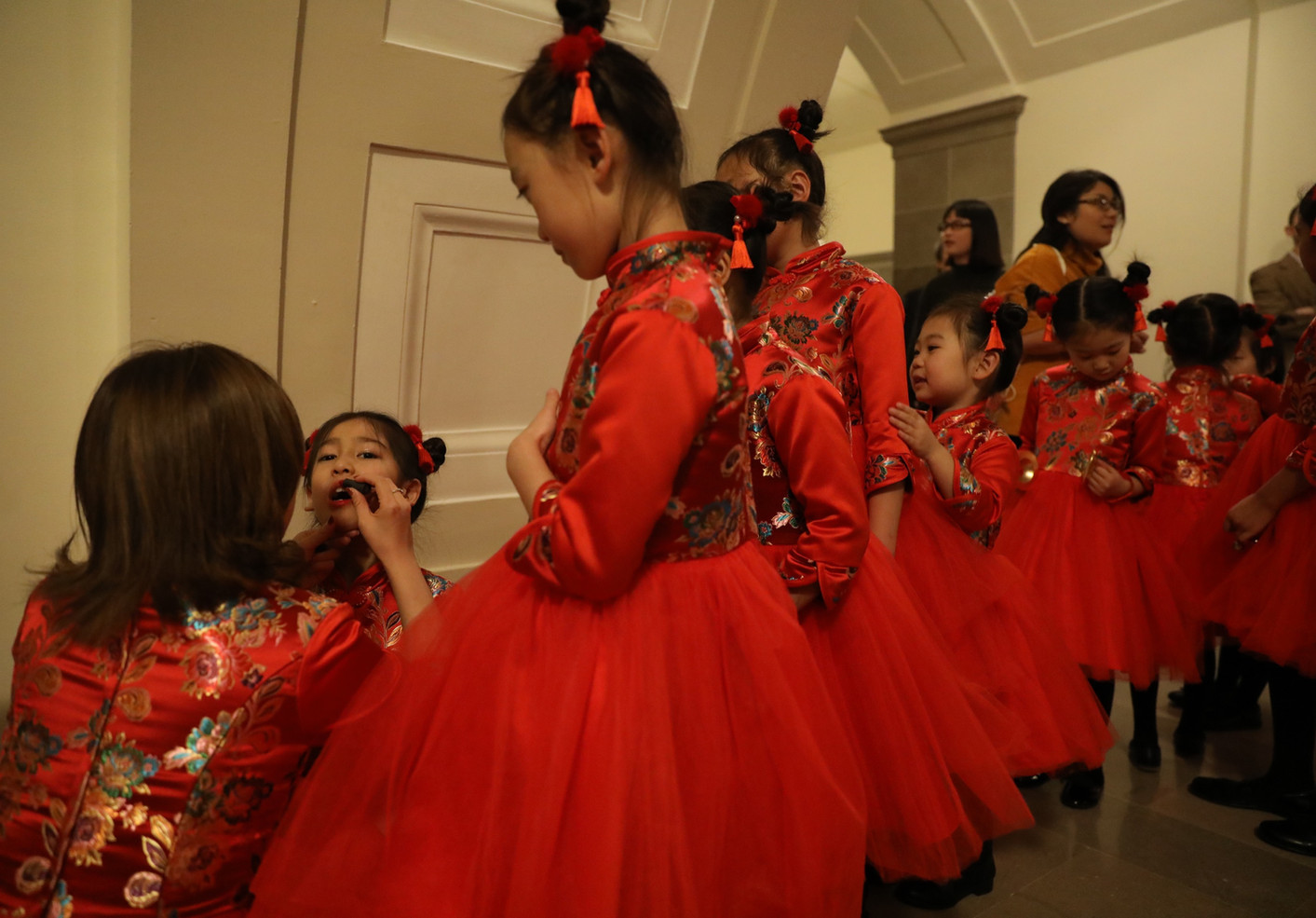 "Students from the Columbia Chinese School stand in line to put on lipstick on Monday, February 4, 2019 at the Missouri Capitol in Jefferson City, Missouri. The students danced to songs ""Guo Xin Nian"" and ""Chun Xiao"" on the eve of the Lunar New Year."