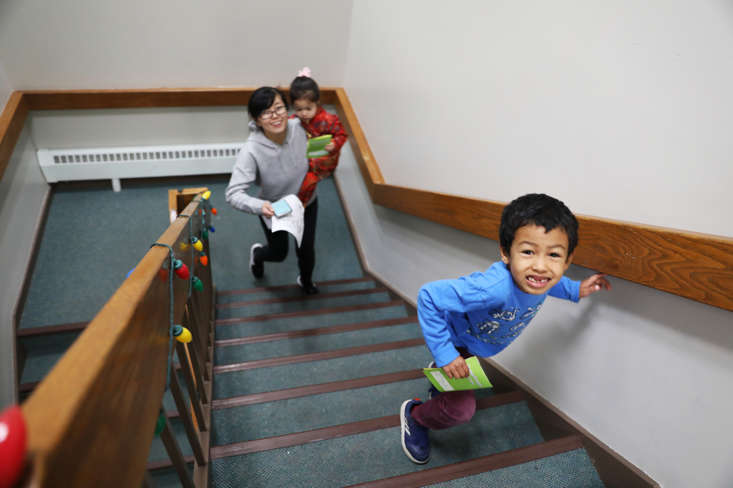 Yan, Jane, and Arthur, from left to right, walk stairs after Children's Sunday School finishing. The family usually go to downtown for lunch and then send Arthur to Chinese language class on Sunday's afternoon.