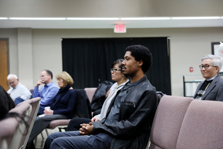Yan and Brandon listen to a sermon on Sunday, December 8, 2019 in International Community Church, Columbia, Missouri. They usually read and discuss some books and articles about religions while having break.